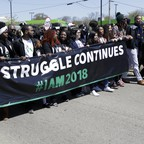 A photo of marchers in Memphis commemorating the 50th anniversary of the assassination of Rev. Martin Luther King Jr. on April 4, 2018.