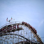 Riders on the Cyclone roller coaster at Coney Island