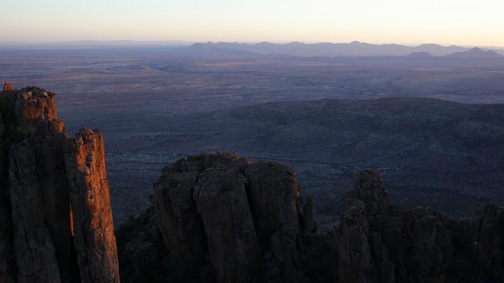 Sunset over desert rocks