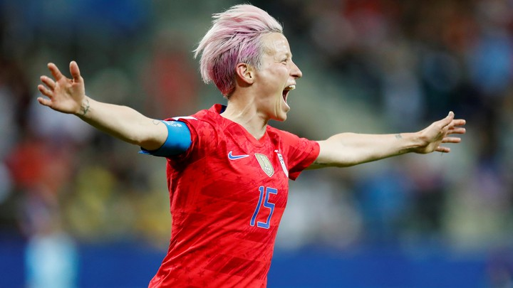 Megan Rapinoe celebrates scoring the ninth goal for the U.S. during a World Cup game.