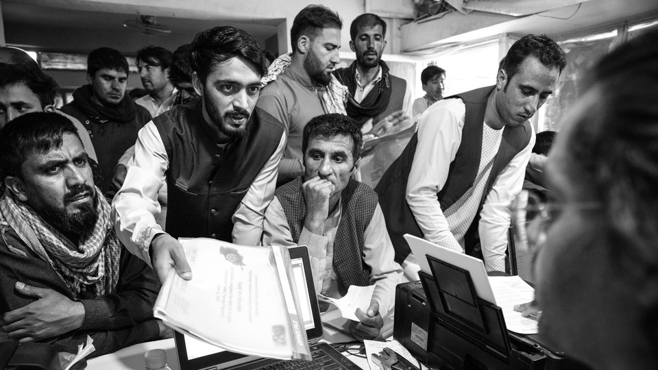 Applicants for a Special Immigrant Visa crowd into a Kabul internet cafe on August 8, 2021.