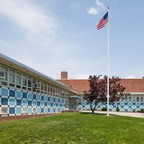 a photo of a high school in Jamaica, Queens, which is an example of modern architecture in Queens