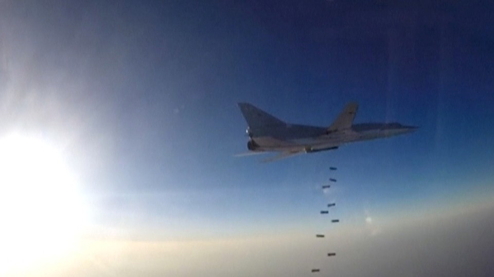 A Russian plane that took off from Iran drops bombs over ISIS targets in Syria.