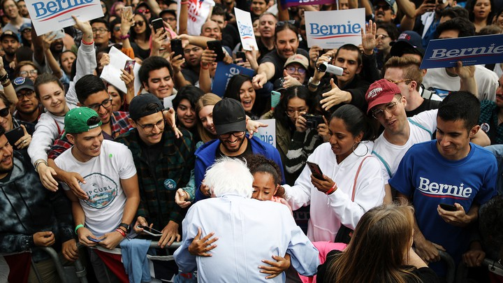 Bernie Sanders with a crowd of supporters