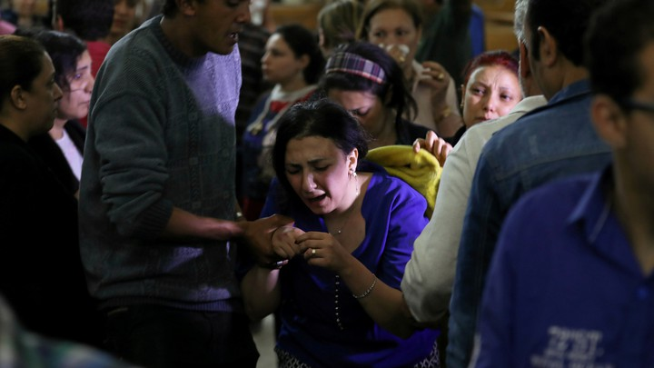 A relative of a victim reacts inside the Coptic church that was bombed on April 9, 2017, in Tanta, Egypt.