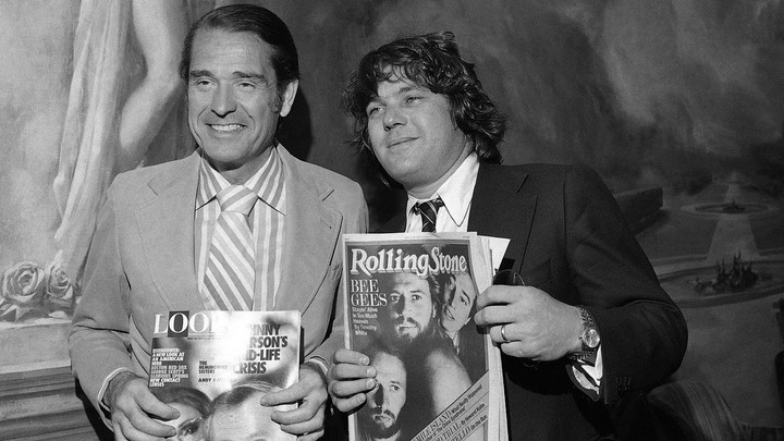The Look Magazine owner Daniel Filipacchi stands with the editor and publisher of Rolling Stone Jann Wenner in 1979.