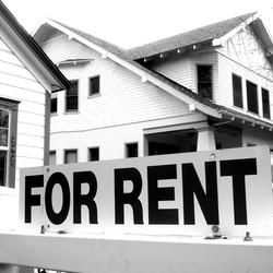 """House with a """"For Rent"""" sign"""