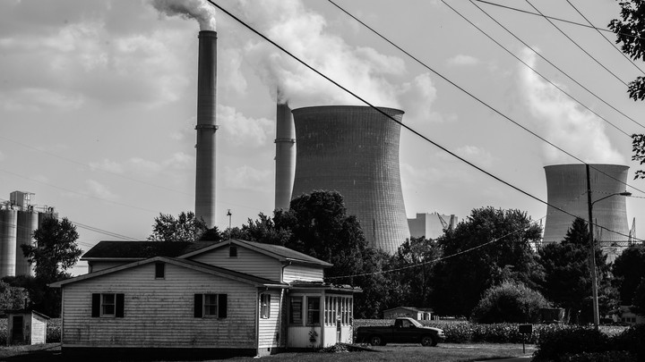 A house is seen near the massive Gavin Power Plant on September 11, 2019 in Cheshire, Ohio.