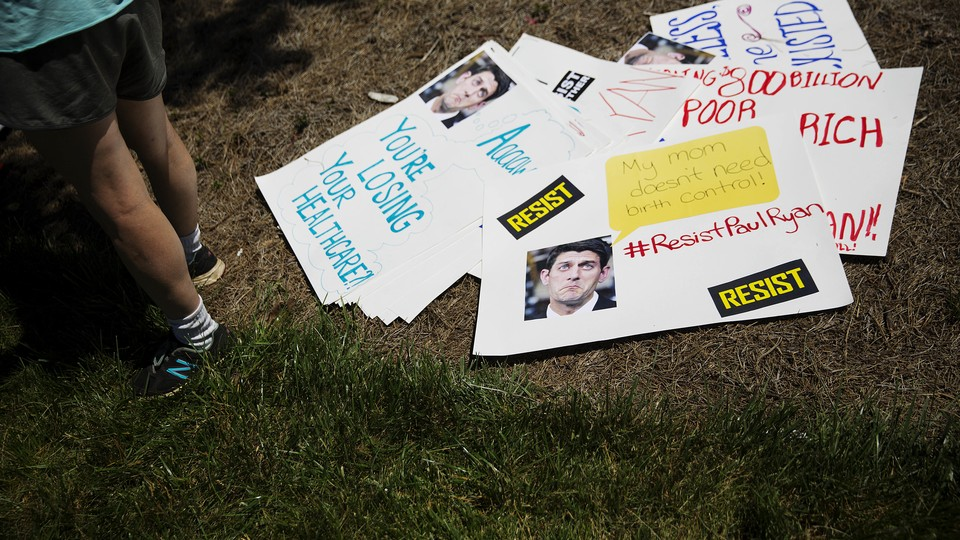 Anti-Paul Ryan signs lay on the ground during a protest in Georgia in May.