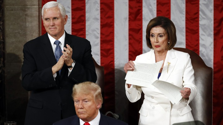 Nancy Pelosi ripping President Trump's speech in half during the State of the Union address.