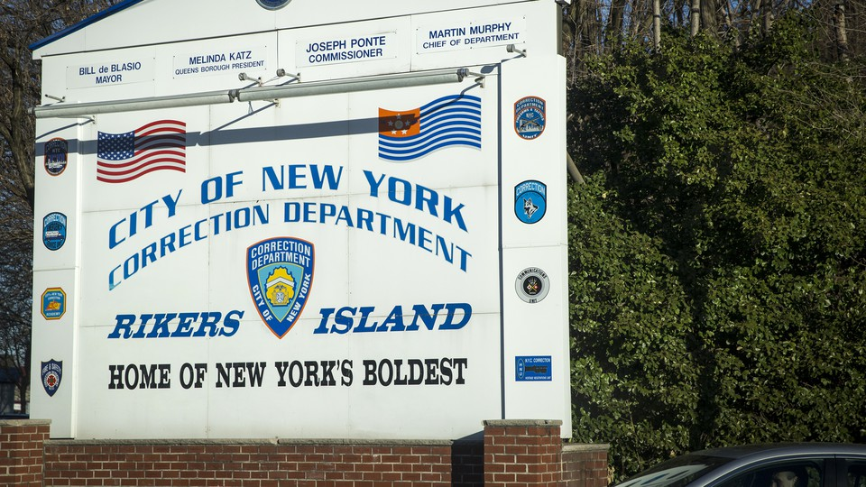 """A sign reading """"City of New York Correction Department: Rikers Island, Home of New York's Boldest"""""""