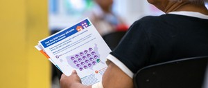 photo: A jobseeker holds an information packet during a U.S. Census Bureau 2020 job opportunities workshop in 2019.