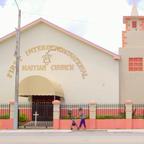 A woman walks past the First International Haitian Church in Little Haiti.