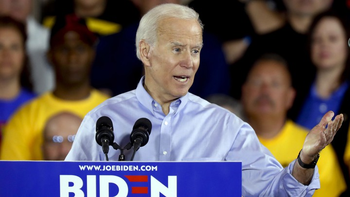 Joe Biden, flanked by union members, speaks at his campaign kickoff rally in Pittsburgh.