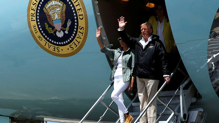 President Trump and First Lady Melania Trump arrive aboard Air Force One to survey hurricane damage, at Muniz Air National Guard Base in Carolina, Puerto Rico.