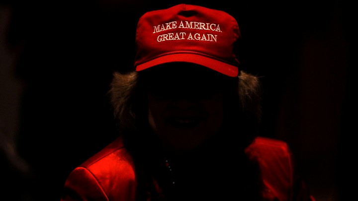 "A Trump supporter wears a ""Make America great again"" hat"