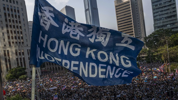 Protesters march to the U.S. consulate in Hong Kong, September 8, 2019. Protesters carrying American flags sought support for a bill in Congress that would punish Chinese officials who suppress freedoms in the city.