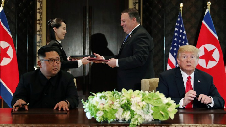 Mike Pompeo stands with Kim Jong Un's sister Kim Yo Jong behind Trump and Kim at their meeting in Singapore in June.