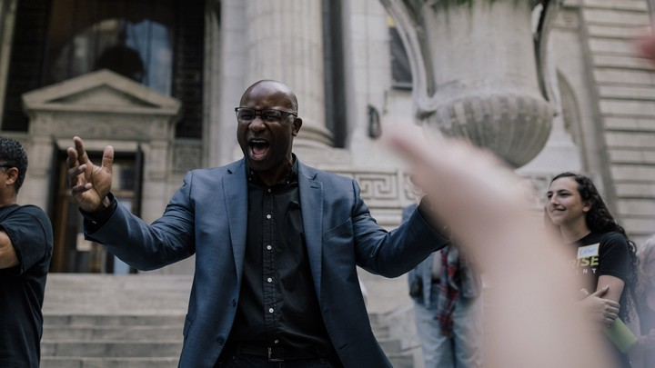 Jamaal Bowman speaks to a crowd during a rally in New York City