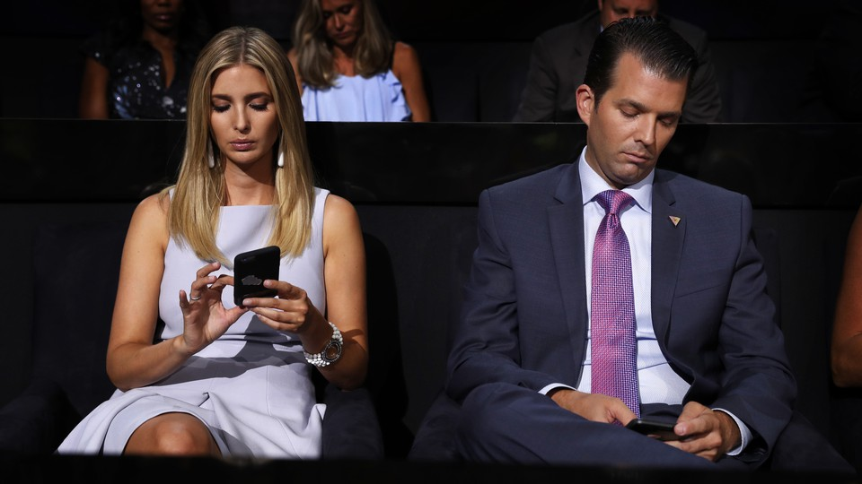 Ivanka Trump and her brother, Don Jr., use their cellphones while seated at the 2016 GOP convention.