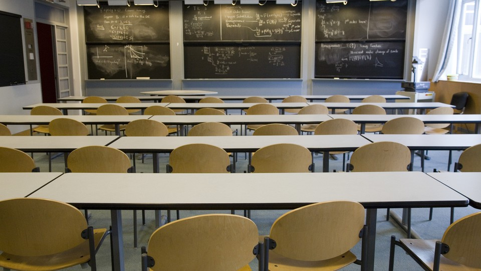 A classroom, with writing on the blackboard, at MIT