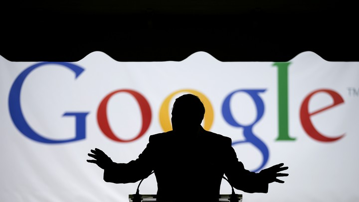 """Georgia Governor Nathan Deal speaks silhouetted in front of a large screen that says """"Google."""""""