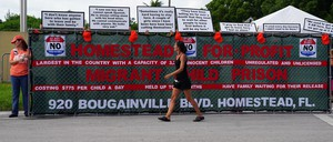 A sign says Homestead for profit immigrant child prison.