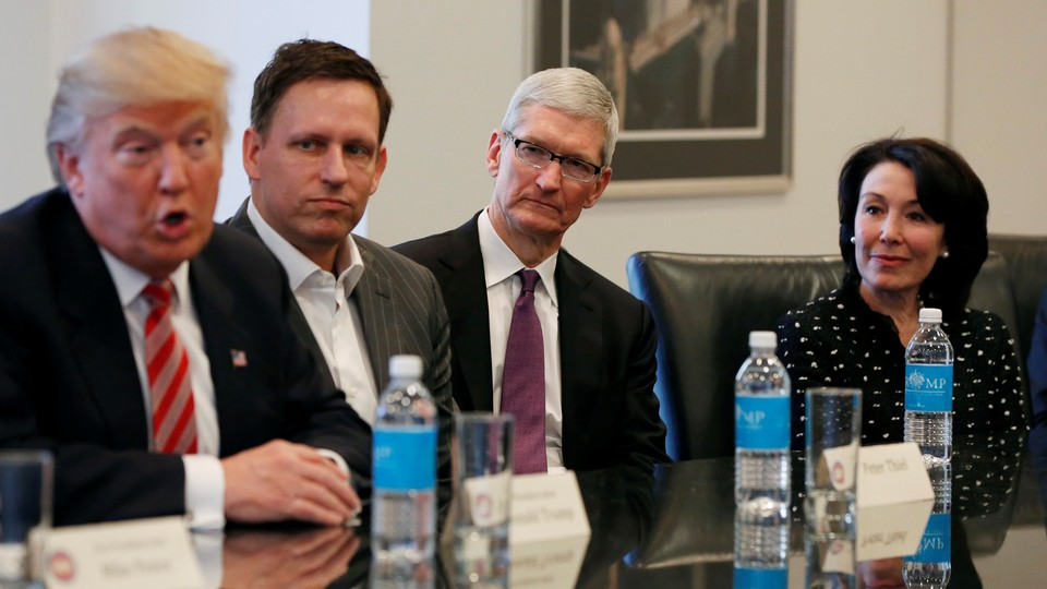 Donald Trump at a meeting in December with the tech investor Peter Thiel, Apple's CEO, Tim Cook, and Oracle's CEO, Safra Catz