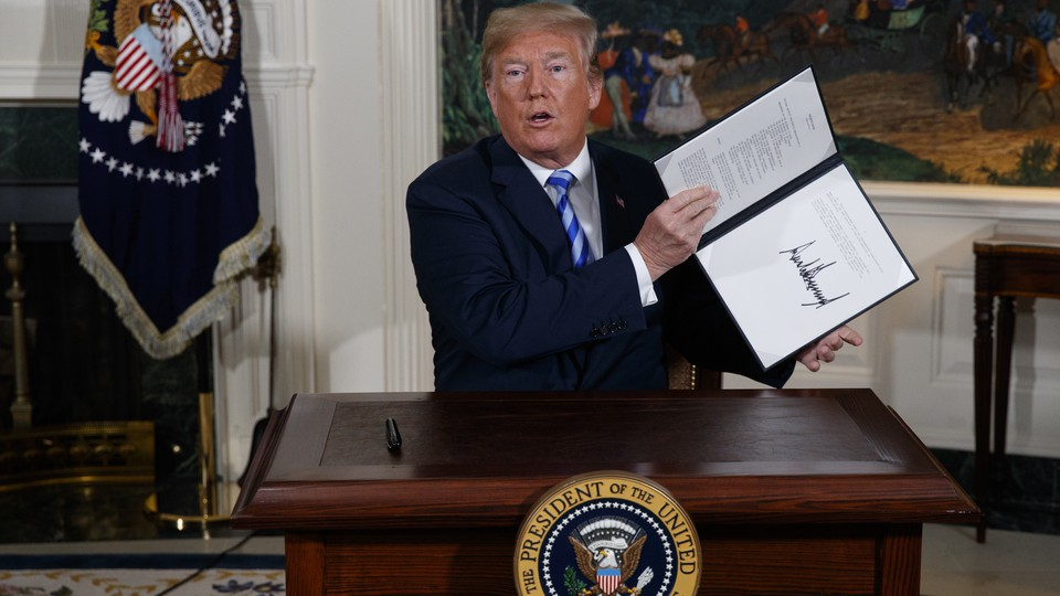 President Trump holding a signed memorandum
