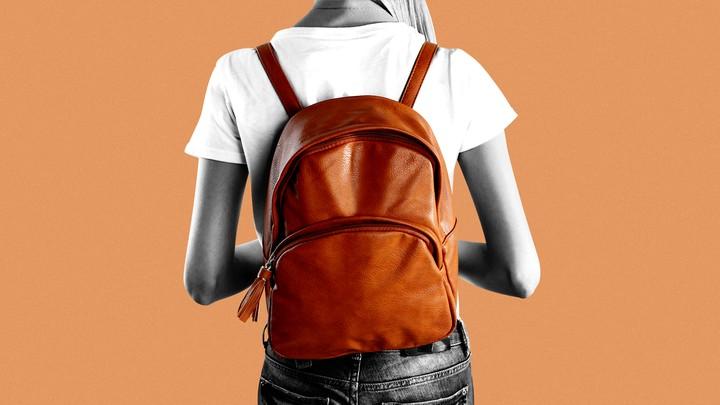 A woman wearing an orange backpack