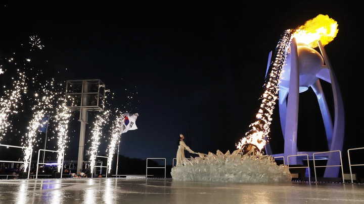 South Korean Olympic figure skating champion Yuna Kim lights the Olympic flame