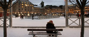 A photograph of a visitor to the Kungstradgarden ice rink in downtown Stockholm, Sweden.