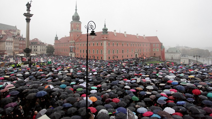 Thousands of people gather during an abortion-rights demonstration to protest against plans for a total ban on abortion in front of the Royal Castle in Warsaw, Poland, on October 3.