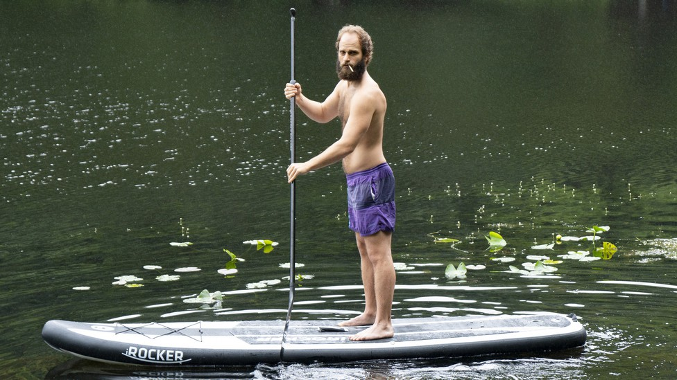 Ben Sinclair on a stand-up paddleboard in 'High Maintenance.'
