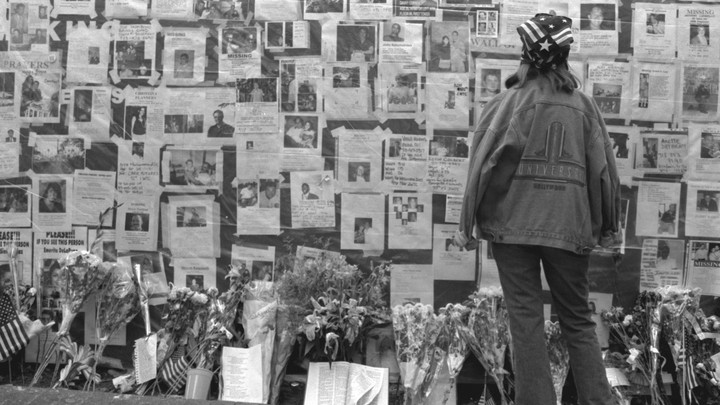 A woman looks at photos of those who went missing on September 11 in New York City.