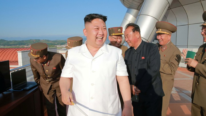 North Korean leader Kim Jong Un reacts to a previous test-fire of a cruise rocket.