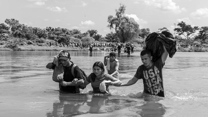 image of people wading through water