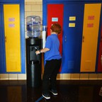 A boy gets water from a cooler at his school in Flint, Michigan.