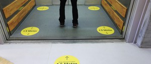 photo: Social-distancing stickers help elevator passengers at an IKEA store in Berlin.