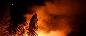 A firefighter battles the Ponderosa Fire east of Oroville, California, in late August.