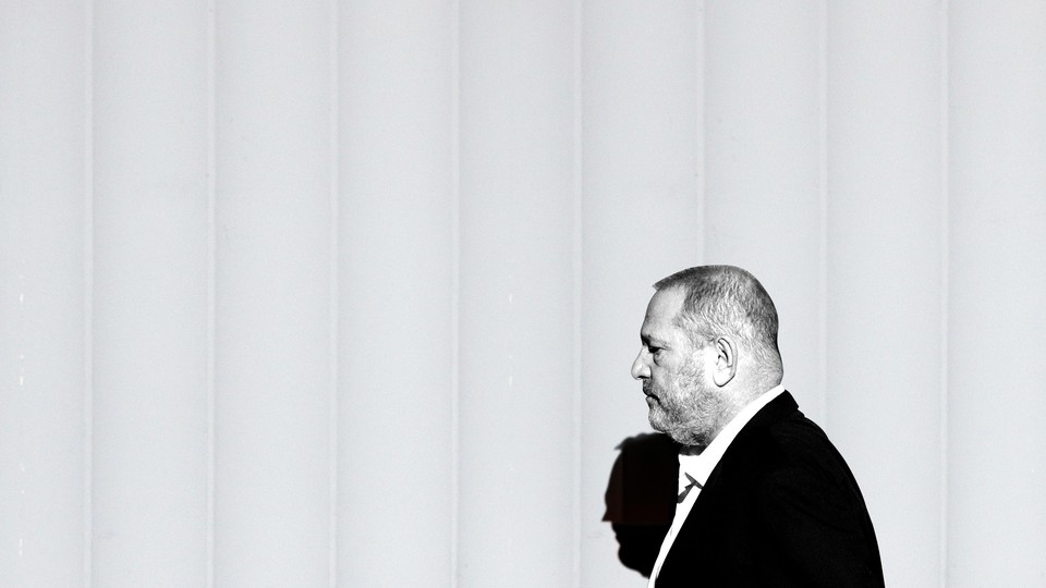 A black and white photo of Harvey Weinstein