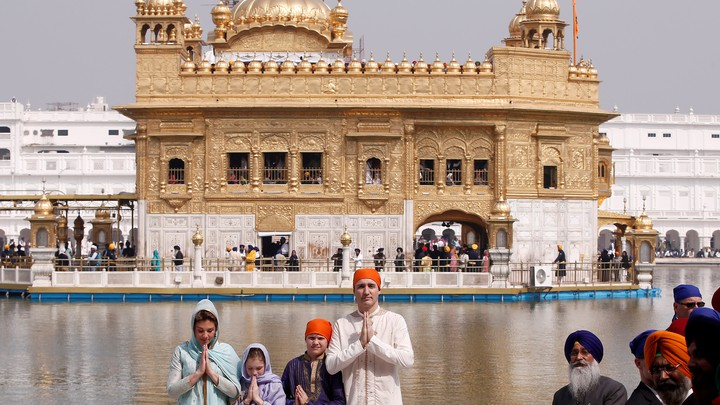 The Trudeaus pose outside the Golden Temple