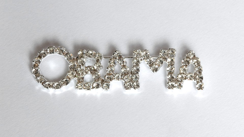"""A rhinestone pin spelling out """"OBAMA"""""""