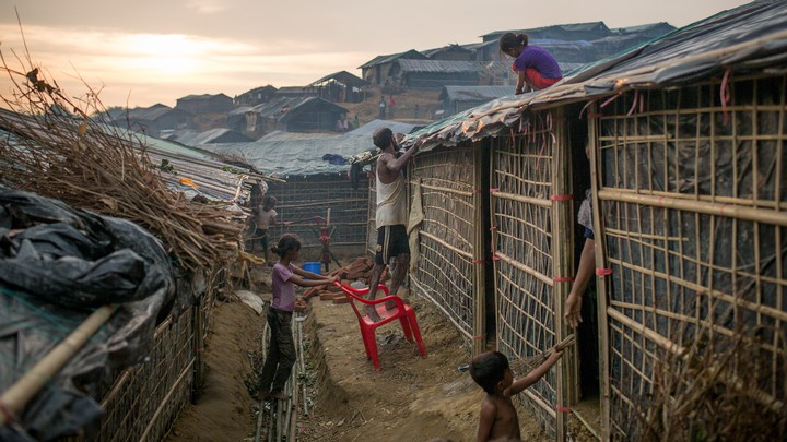 Rohingya refugees fix their temporary shelter at a camp in Cox's Bazar.