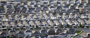Aerial view of new single-family homes on curving streets.