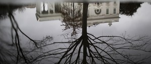 The White House is seen reflected during a rainy day in Washington, D.C.