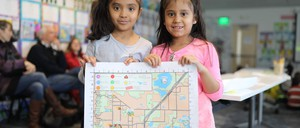 photo: Boulder second-graders pose with an in-progress draft of the Growing Up Boulder map.