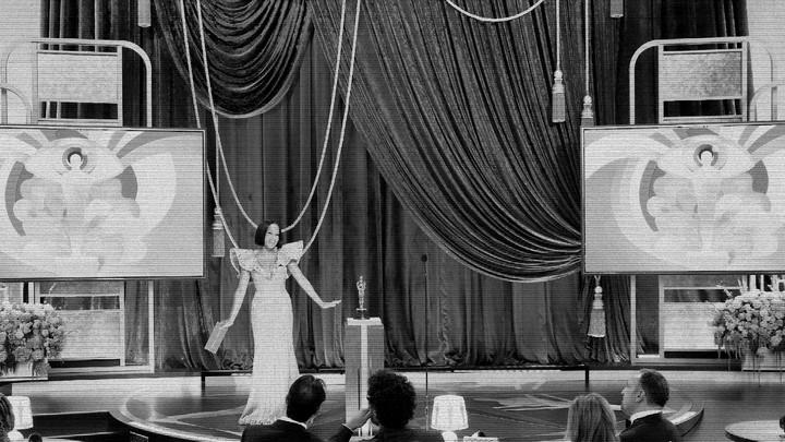 A stylized still of Regina King at the Oscars