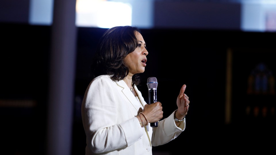 Kamala Harris speaks into a microphone.