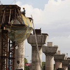 A photo of an elevated highway being constructed.